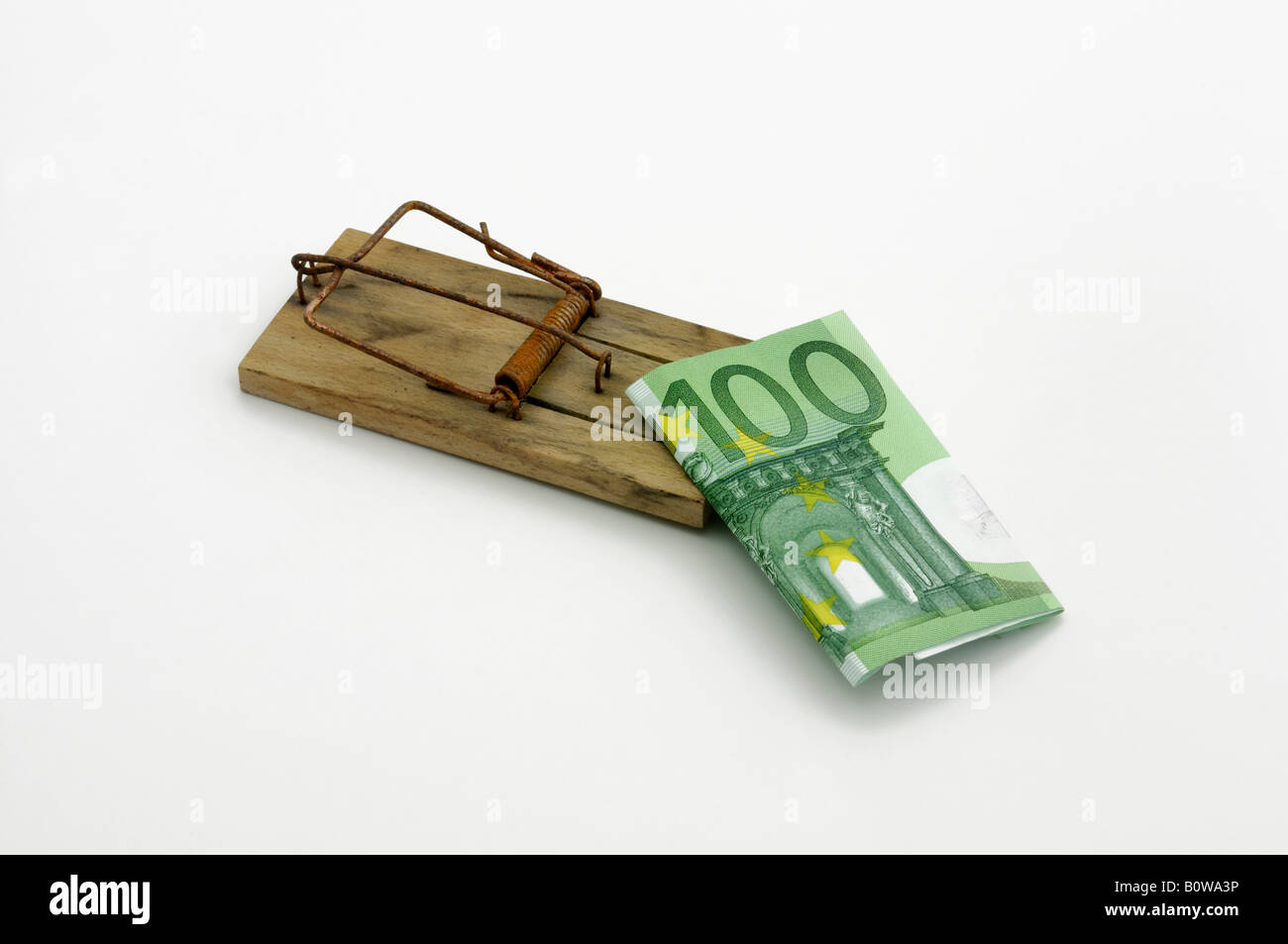 Set mousetrap with a 100-Euro bill as bait Stock Photo