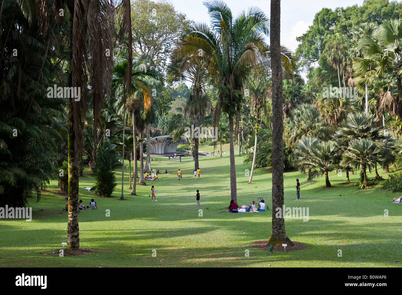 Young people enjoying the parkland of the Botanical Gardens, National Orchard Garden in Singapore, Southeast Asia - Stock Image