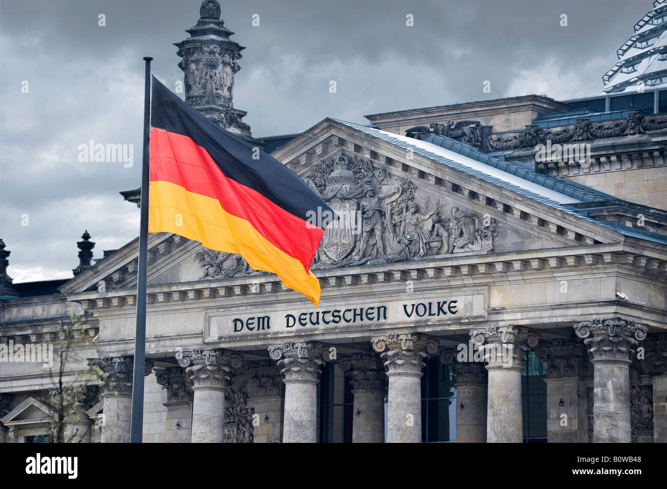 German flag, Reichstag, German parliament building, Berlin, Germany - Stock Image