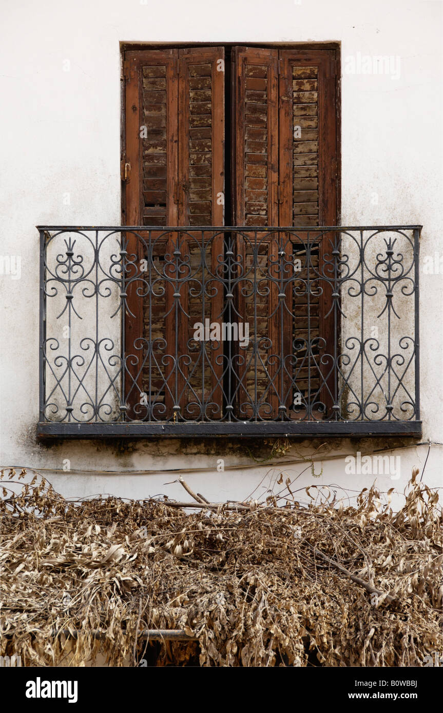 Old balcony and door above a thatched roof, El Rocio, Andalusia, Spain, Europe - Stock Image