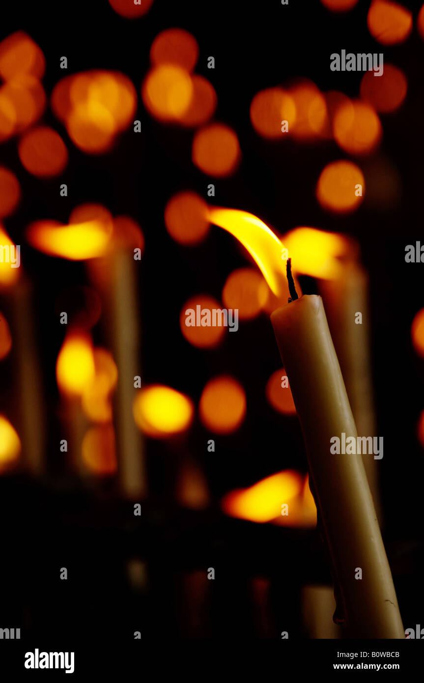 Votive candles in a side chapel of Rocio Church, El Rocio, Andalusia, Spain - Stock Image