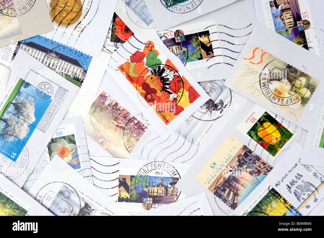 Assorted stamps, clipped from envelopes - Stock Image