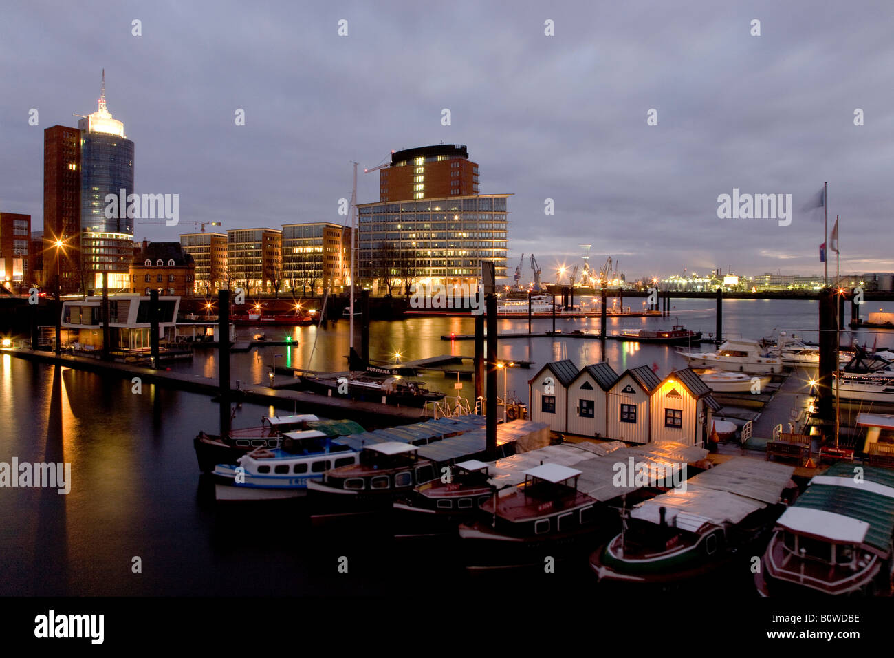 Launches in the harbour of Speicherstadt, modern architecture on the Kehrwiederspitze, Hamburg, Germany, Europe - Stock Image