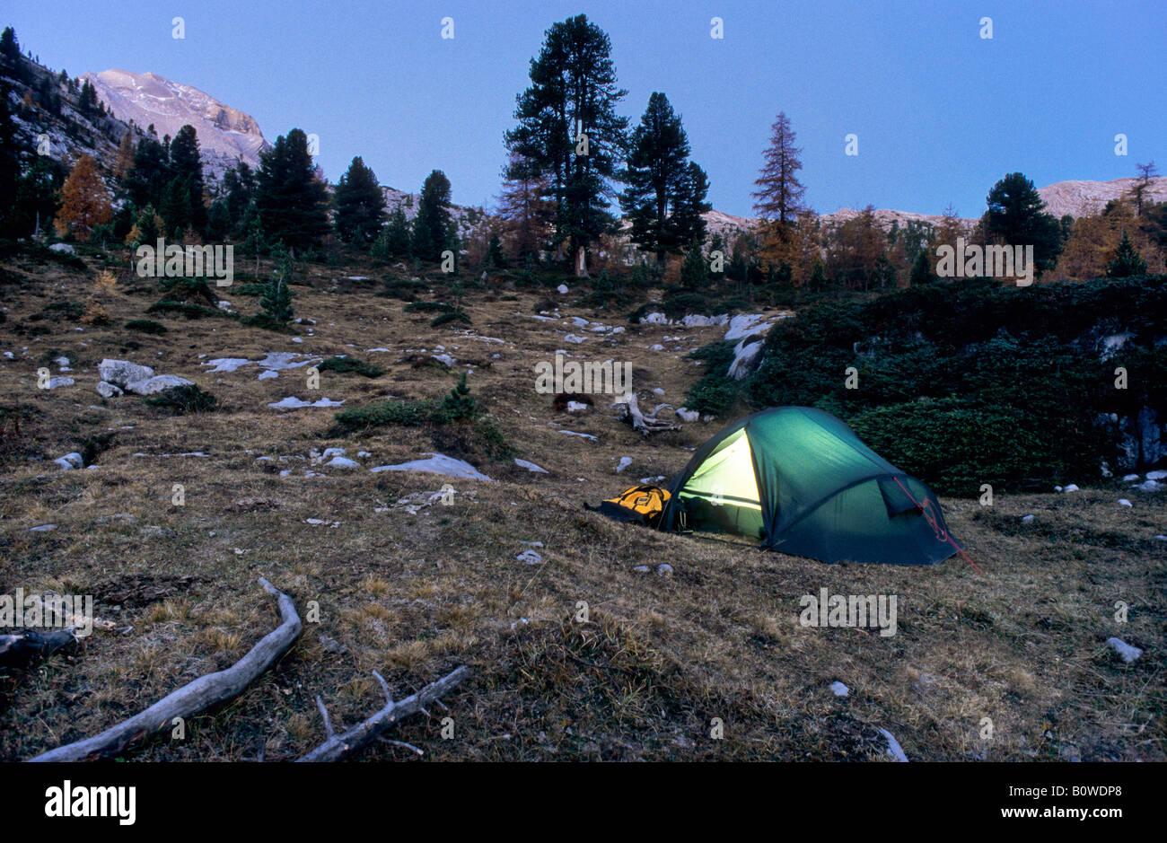Illuminated tent, twilight, autumnal mountain landscape, Fanes Group, Bolzano-Bozen, Italy, Europe Stock Photo