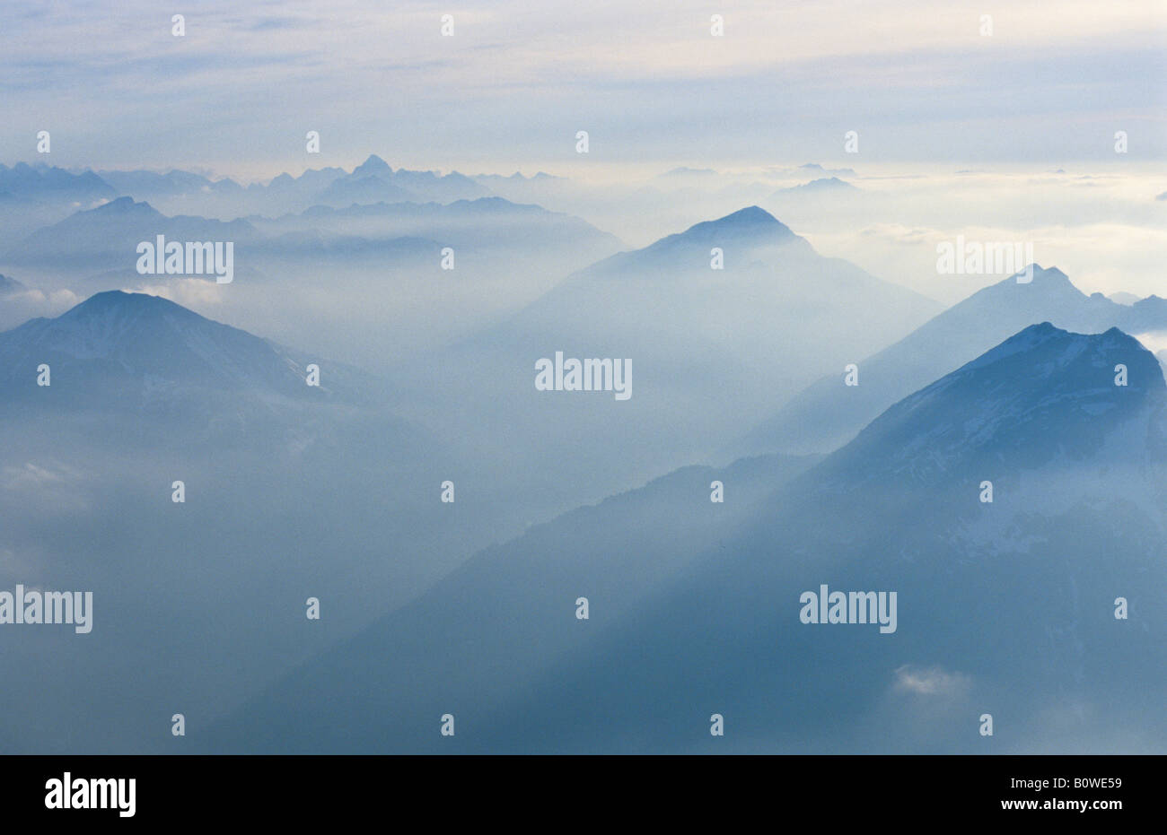 Hazy mountain silhouettes, view from the summit of Mount Zugspitze, Wetterstein, Bavaria, Germany, Europe Stock Photo