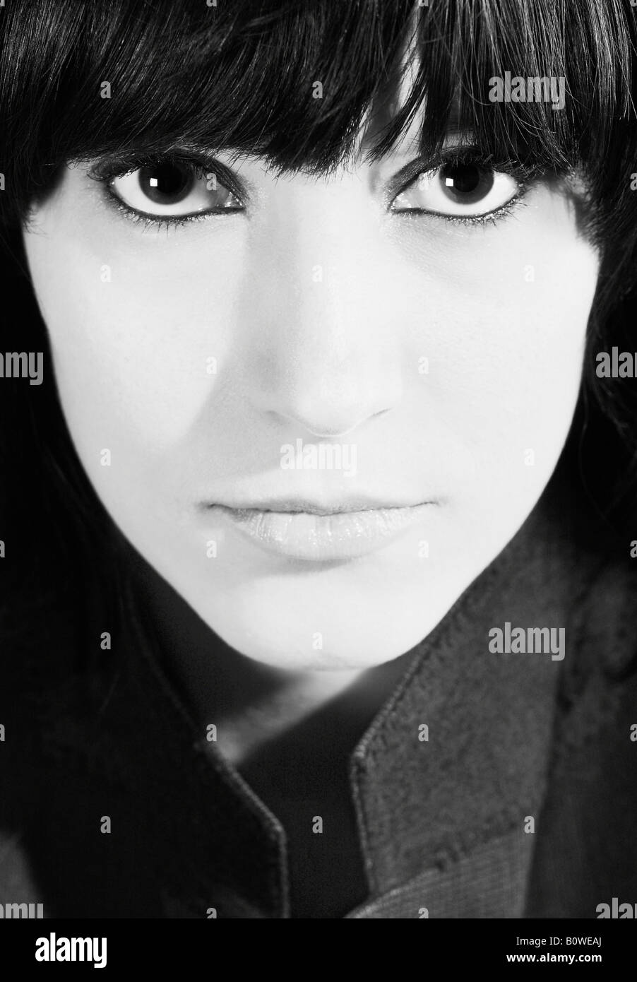 Portrait of a girl with black hair and big eyes, black and white - Stock Image