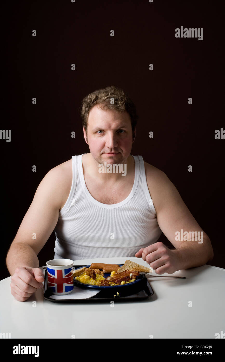 Stereotypical Englishman with an English breakfast - Stock Image