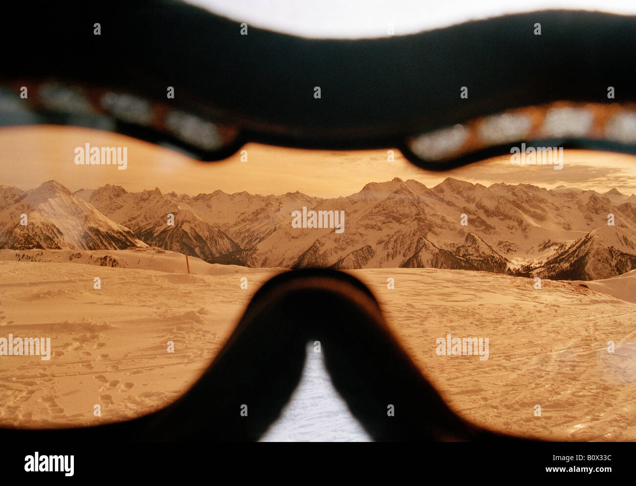 View of a mountain range through a skier's goggles - Stock Image