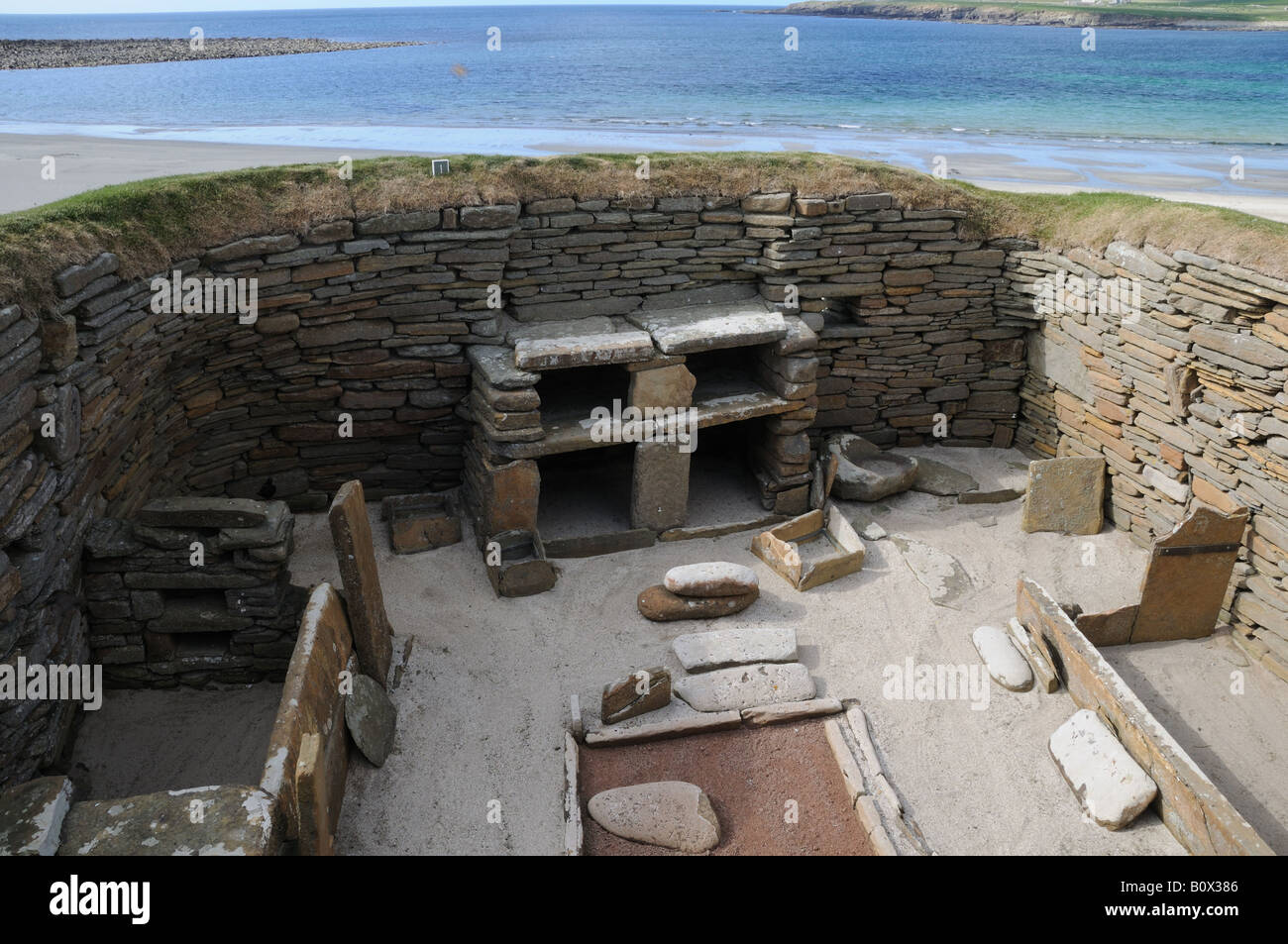 Skara Brae on mainland Orkney is a 5,000-year-old settlement next to the Bay of Skaill. Stock Photo