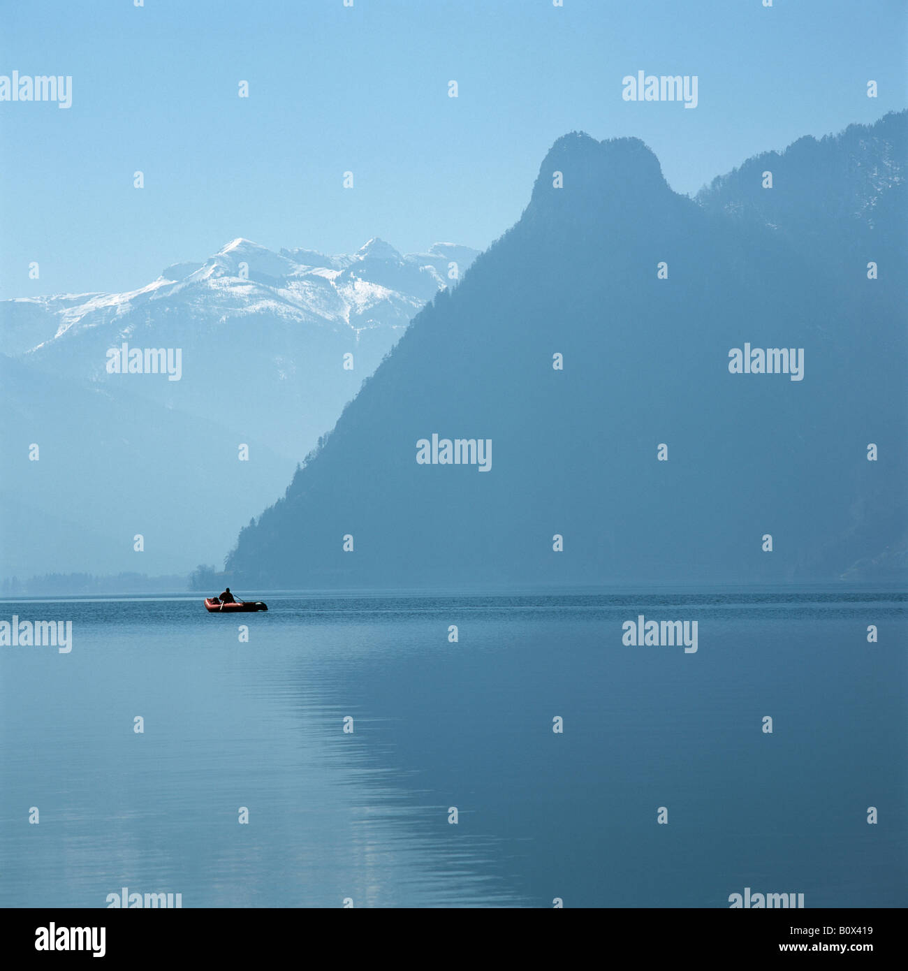 Unrecognizable Person in an Inflatable Raft, Traunsee, Salzkammergut, Austria Stock Photo