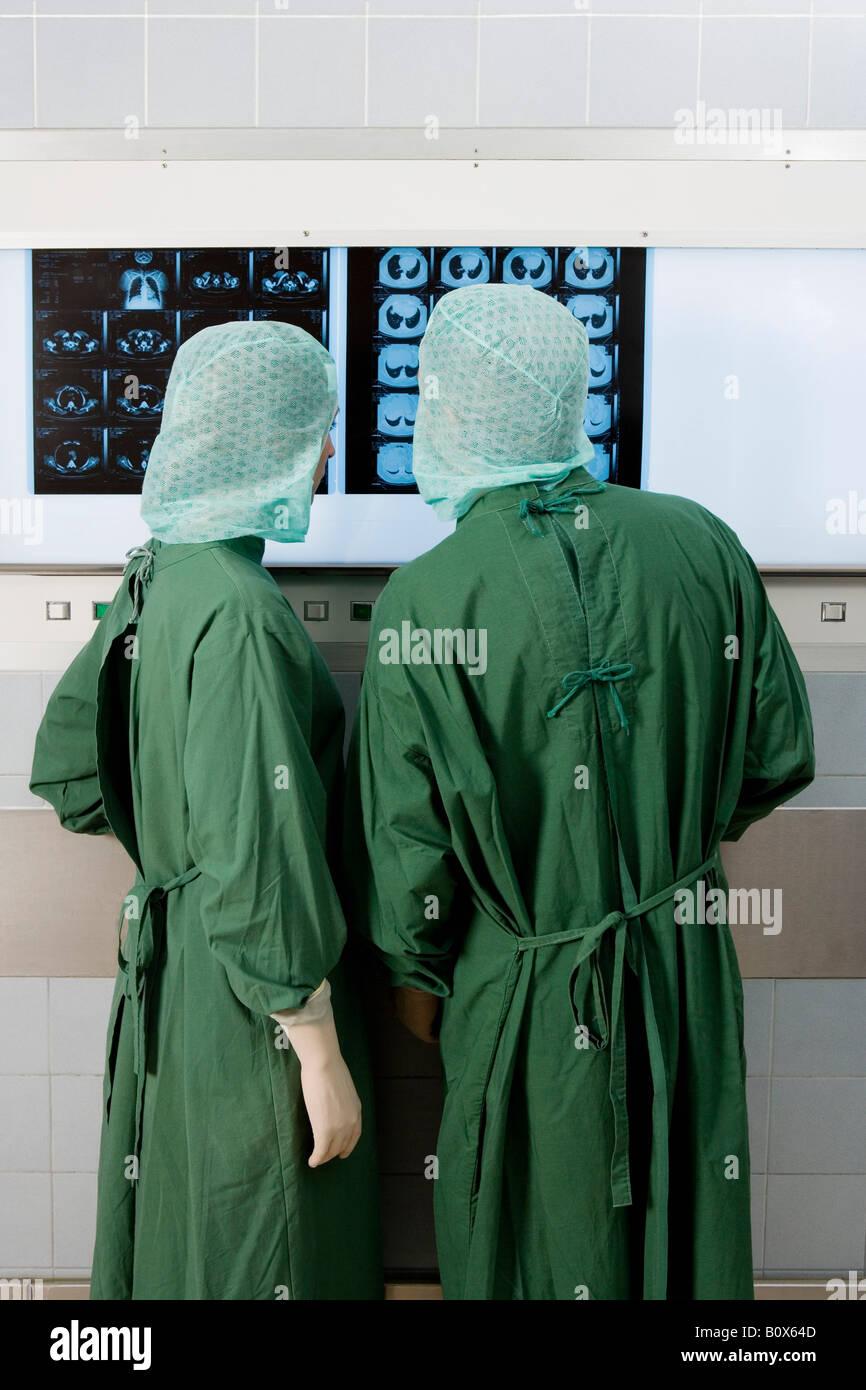 Two surgeons looking at x-rays - Stock Image