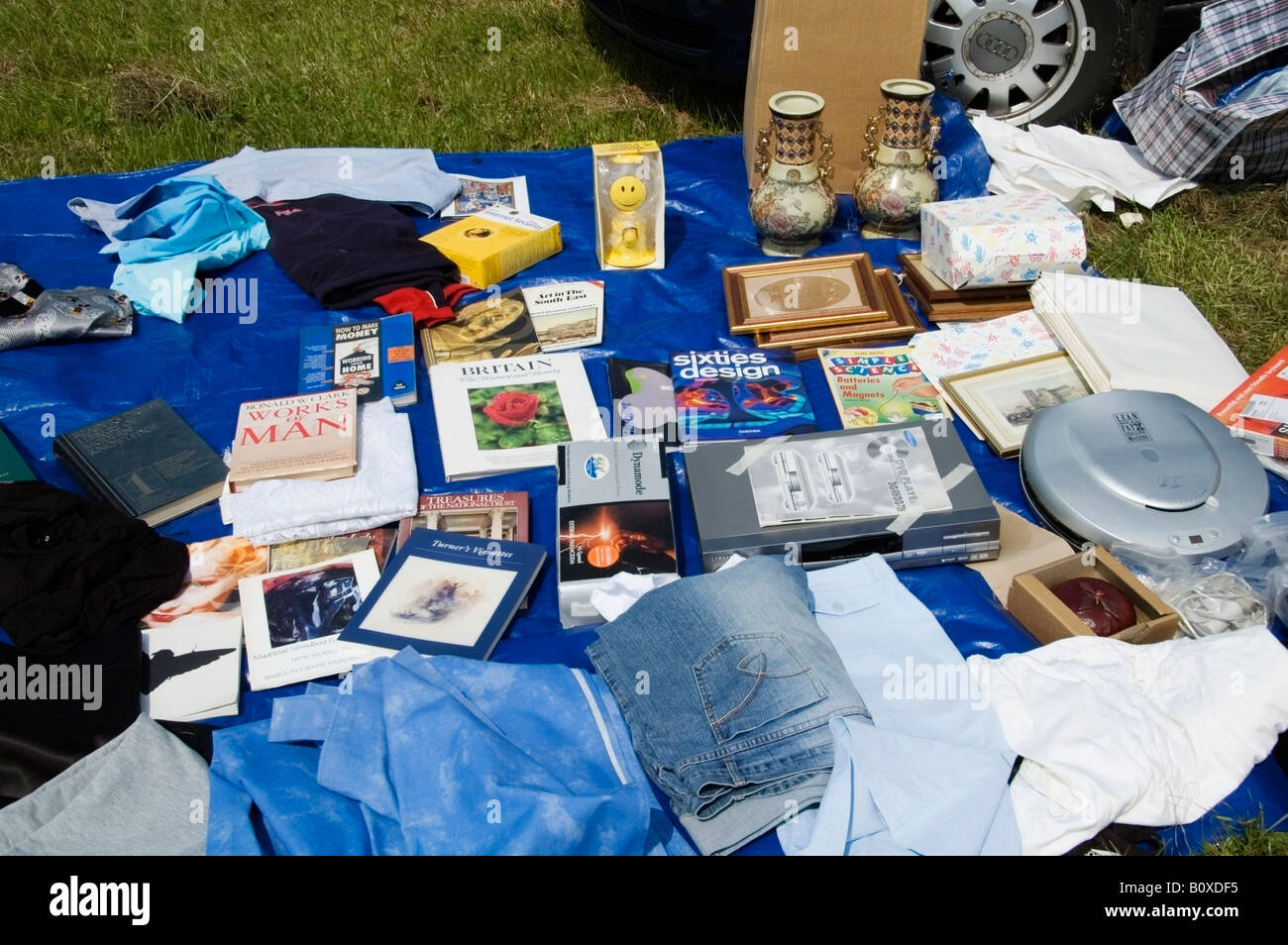 Various outdoor car boot, jumble sale items laid out on a blue ground sheet, spring, Essex, Great Britain, UK, Europe, - Stock Image