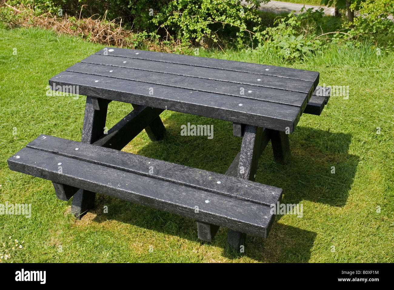 Black picnic bench made from plaswood Clywedog Reservoir Powys Wales UK - Stock Image