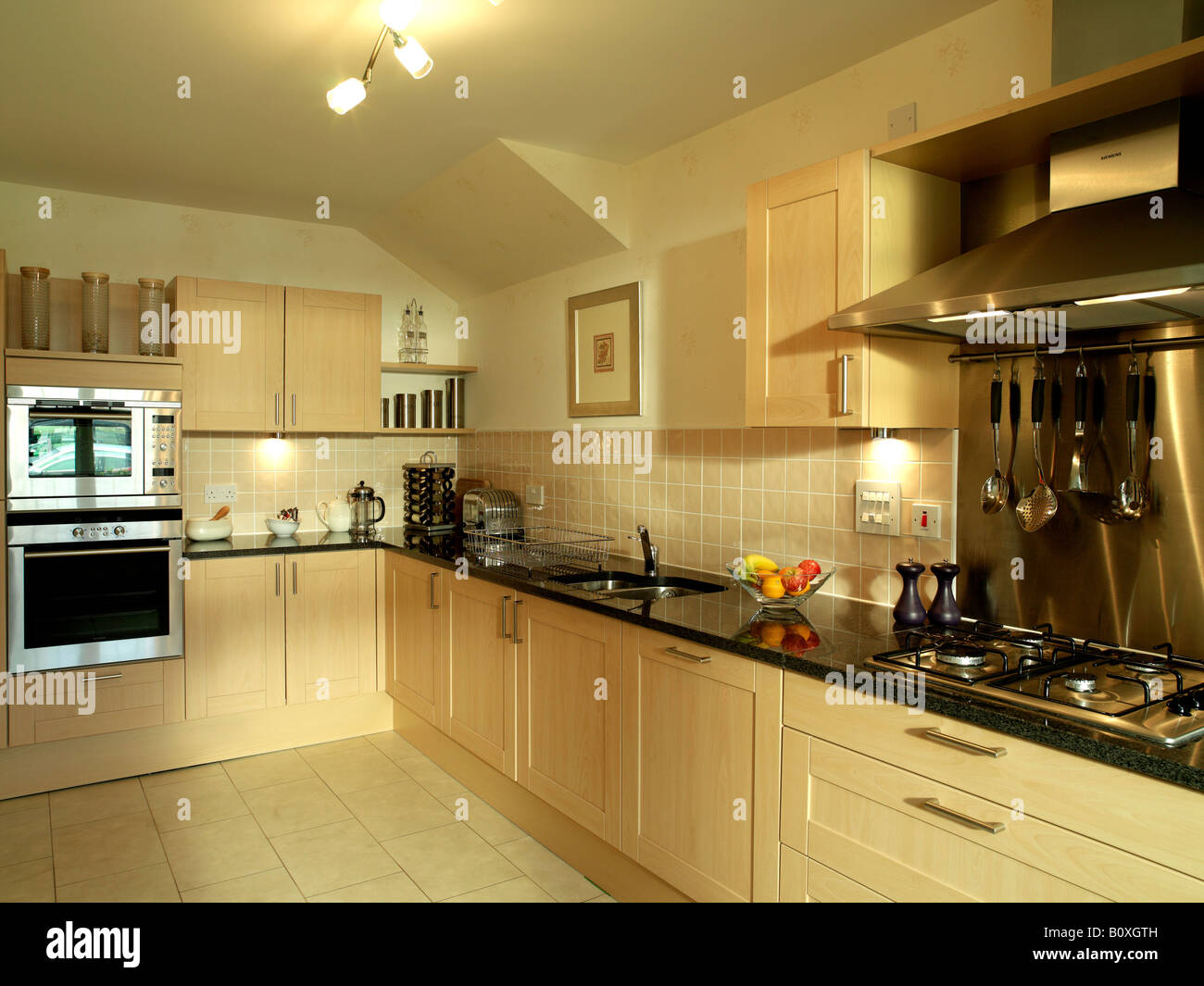 Large Kitchen With Black Marble Worktop Stock Photo Alamy