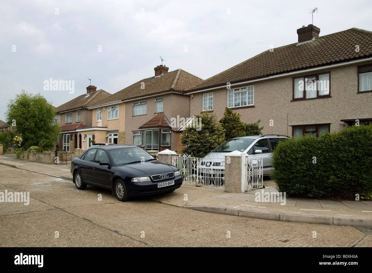 Row of residential street and semi-detached houses of 40s, 50s architecture, Collier Row, Romford, Essex, UK, GB, - Stock Image