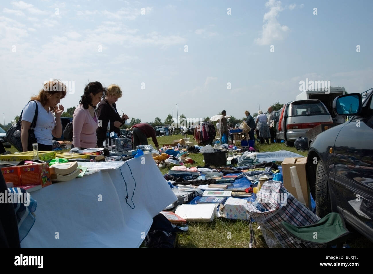 Outdoor car boot, jumble sale on sunny spring day in Essex, English, Great Britain, UK, Europe, EU - Stock Image