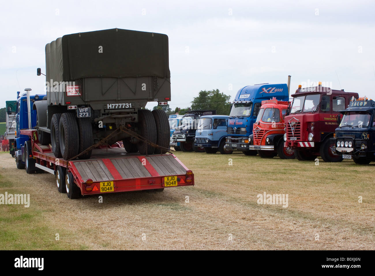 Various Old Articuated Tractor and Flatbed Trucks at Smallwood Vintage Rally Cheshire England United Kingdom UK - Stock Image