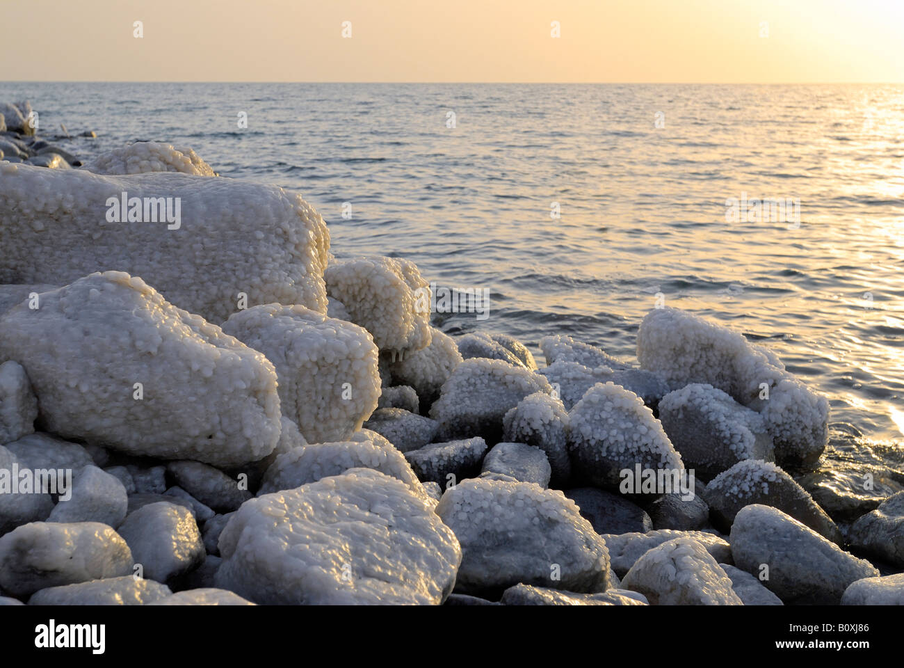rocks with salt at coastline of Dead Sea Jordan Arabia, lowest place on earth Stock Photo