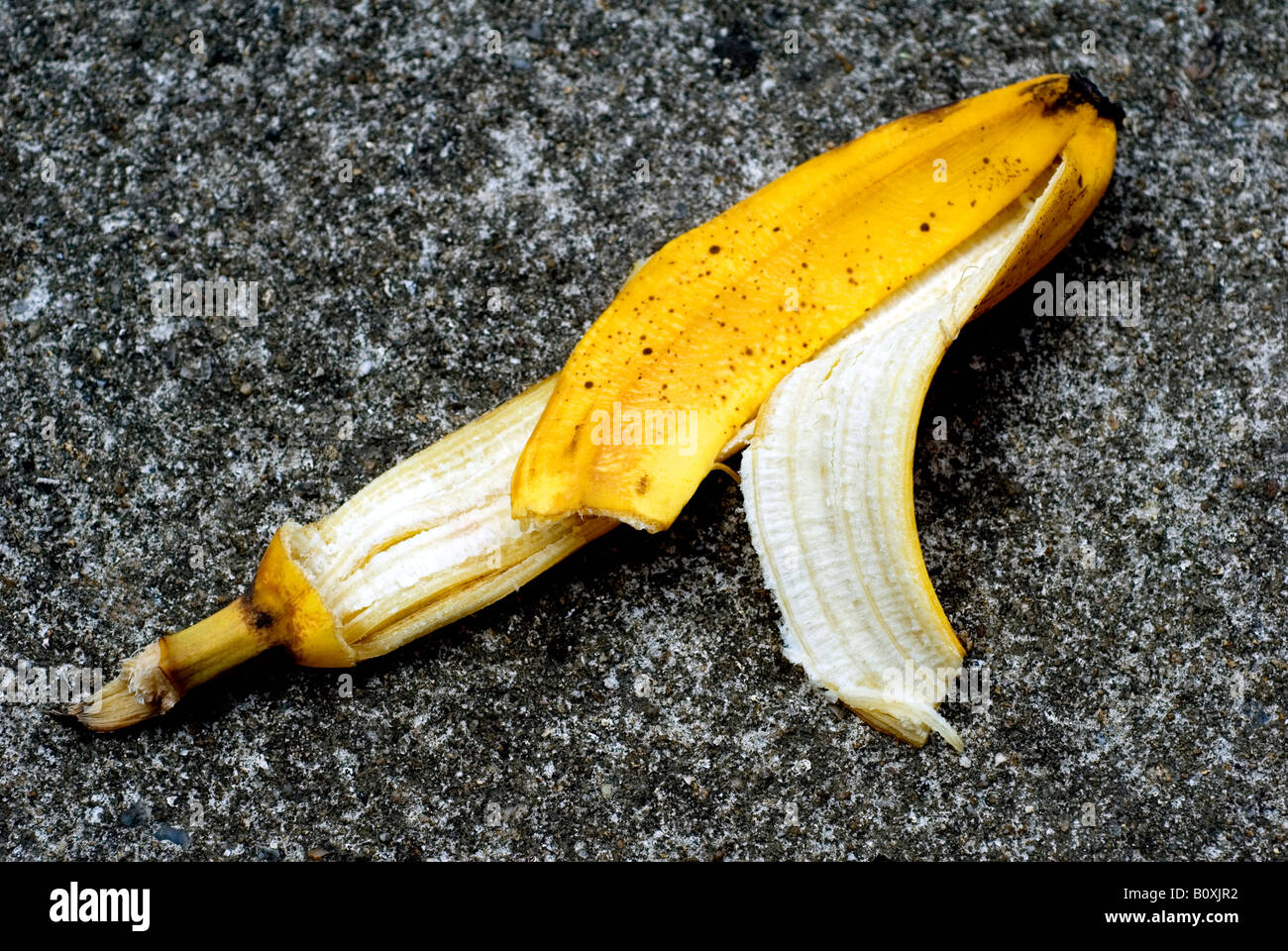 SHOT OF A BANANA SKIN ON A PAVEMENT OR SIDEWALK - Stock Image