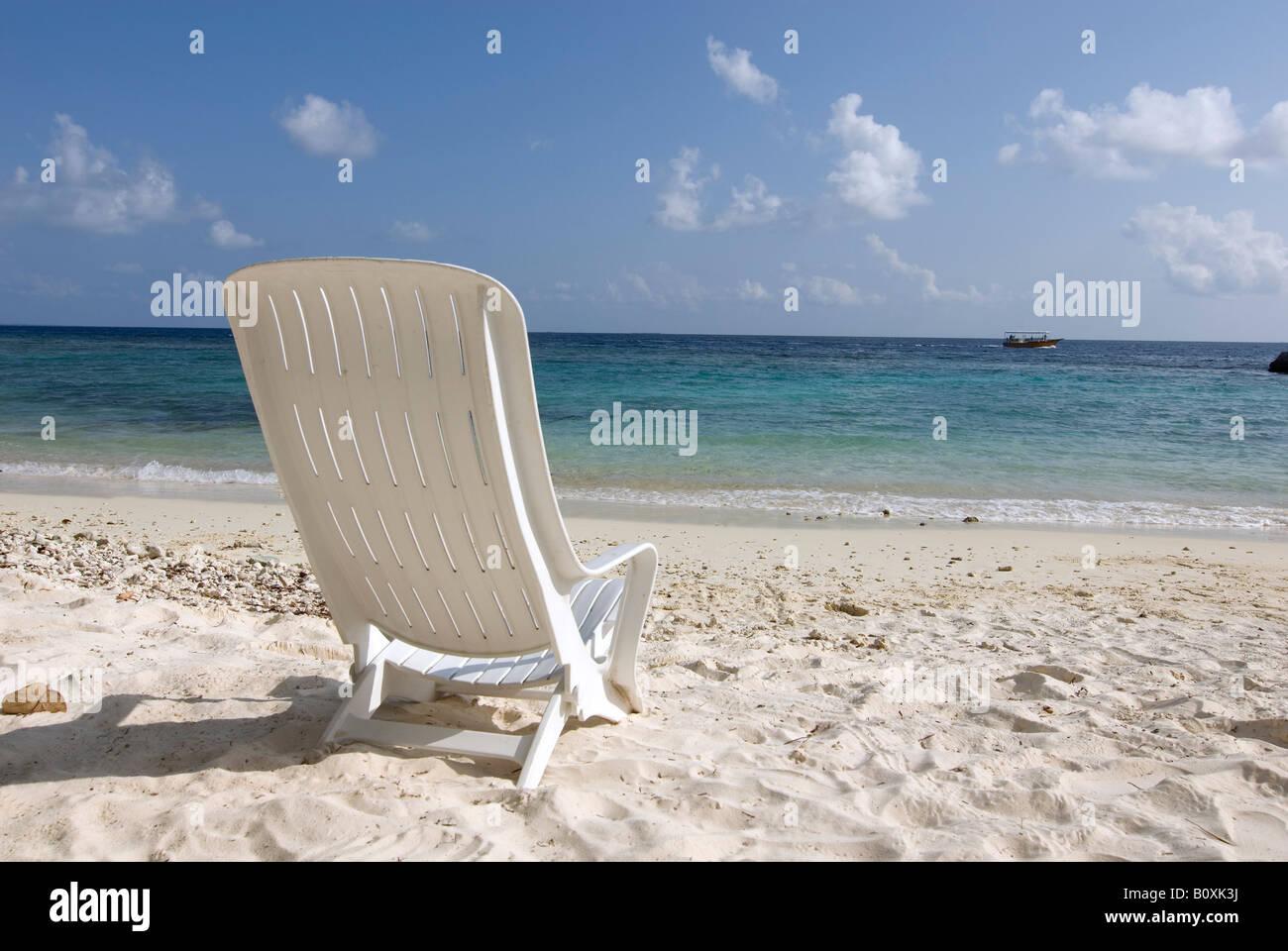 Maledives, Gan, Chair on beach - Stock Image