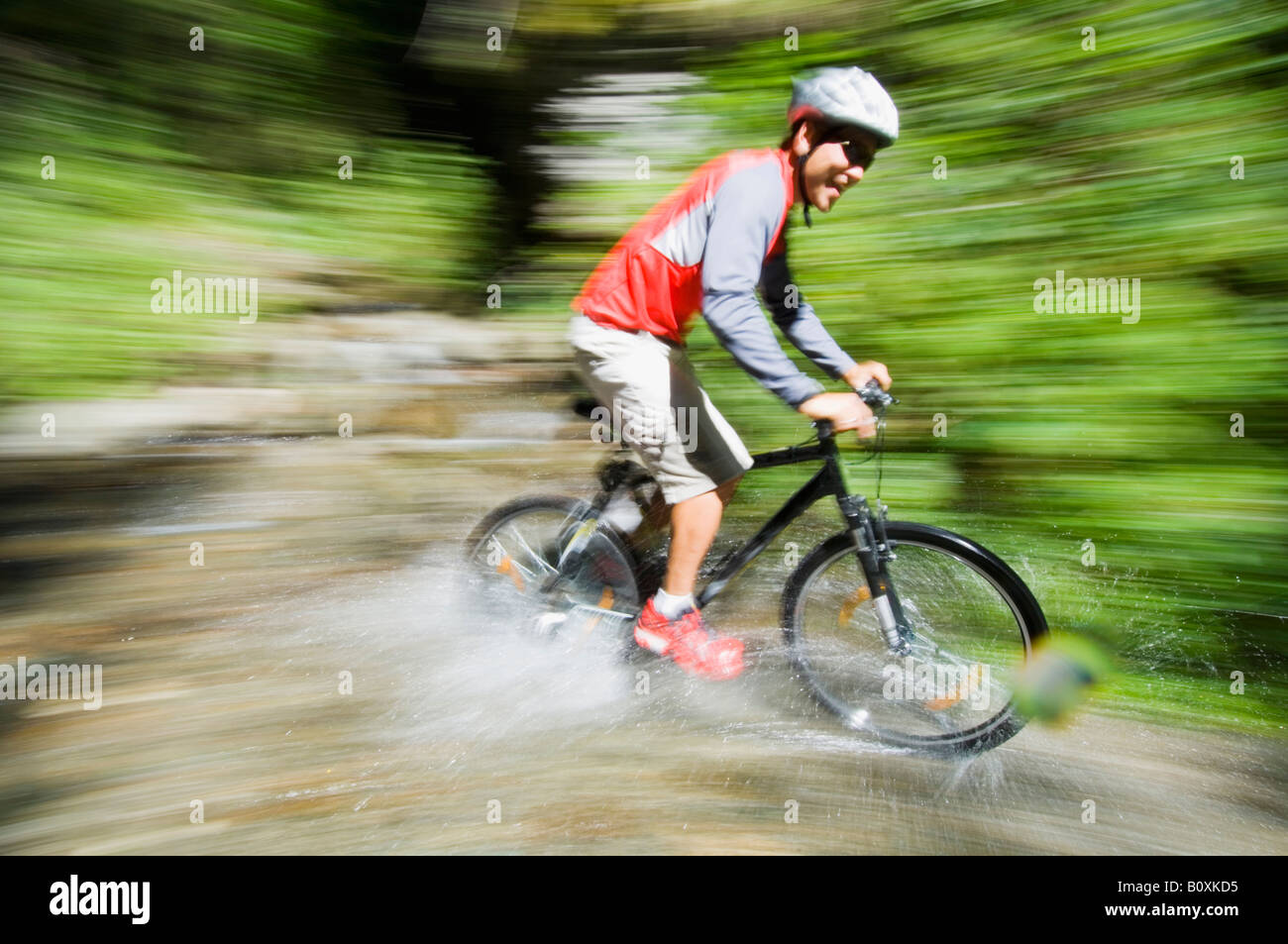 Mountaibiker on the way - Stock Image