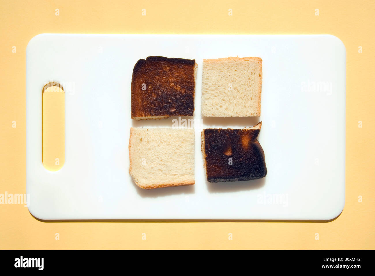 Sliced burnt toast and toast on breakfast plate, elevated view - Stock Image