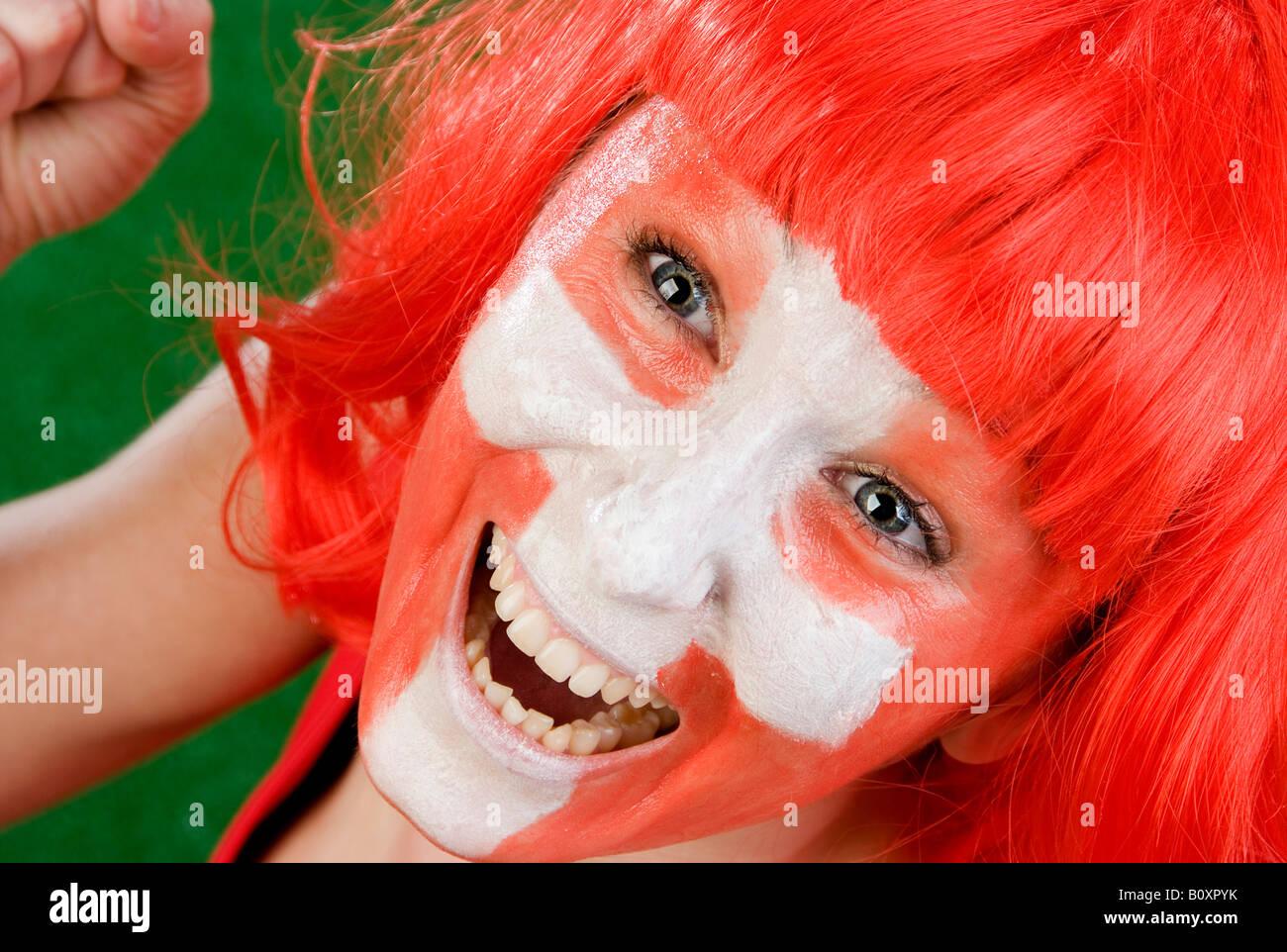 cute woman as Switzerland fan, cheering - Stock Image