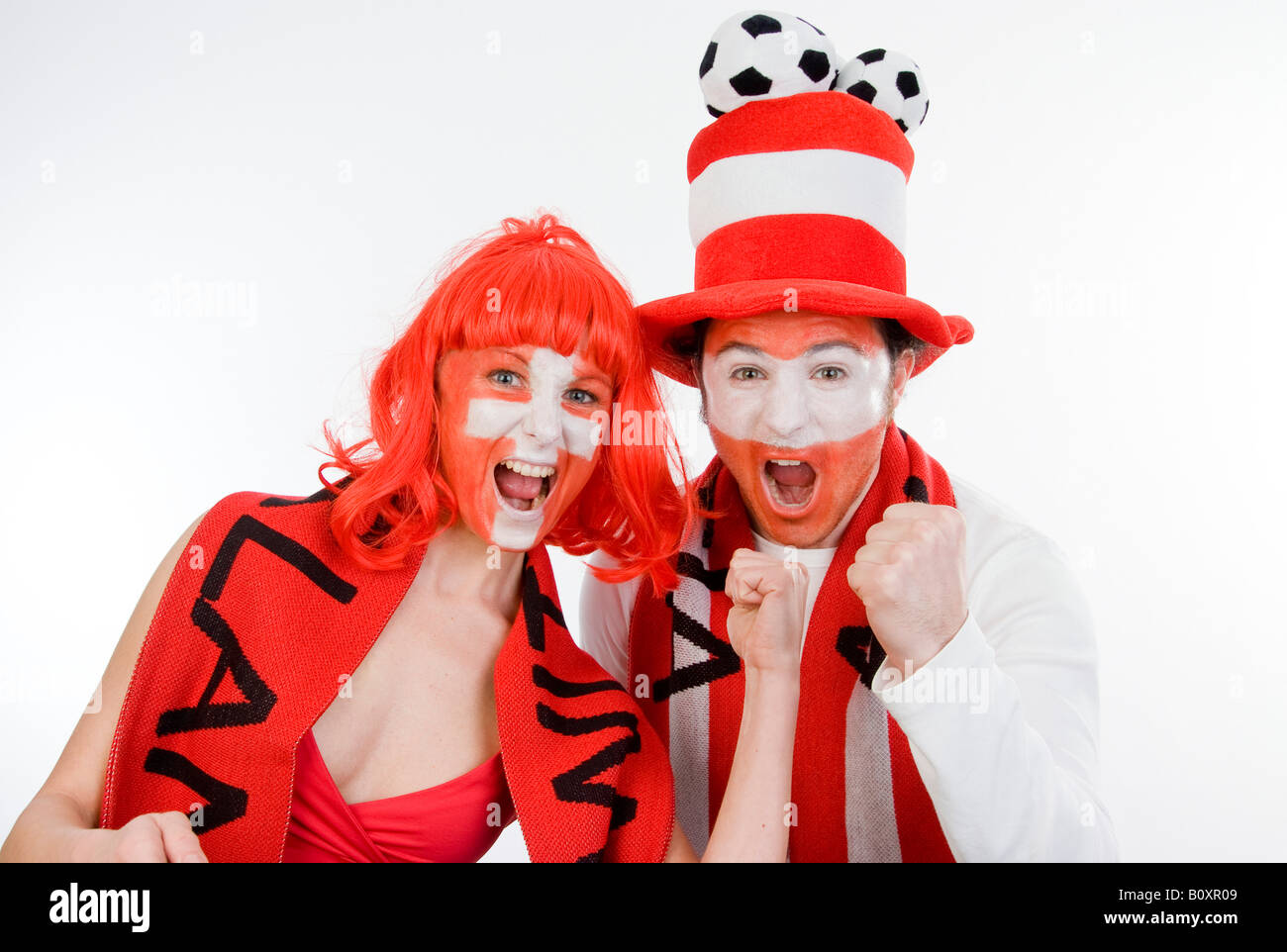 Austrian and Swiss soccer fans, EURO 2008. Man and woman with clenched fists - Stock Image