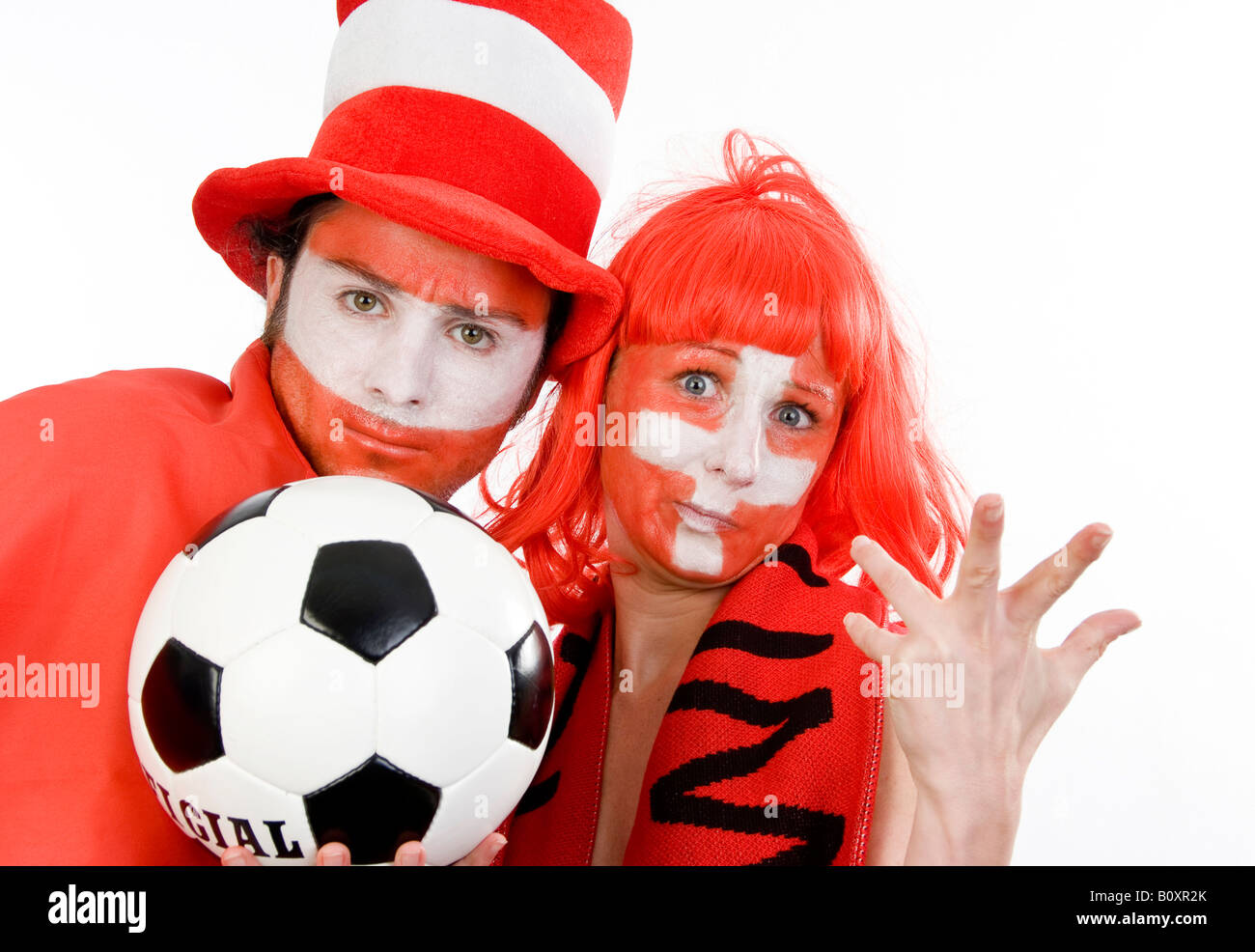 Austrian and Swiss soccer fans, EURO 2008. A man and a woman with football, looking pessimistically - Stock Image