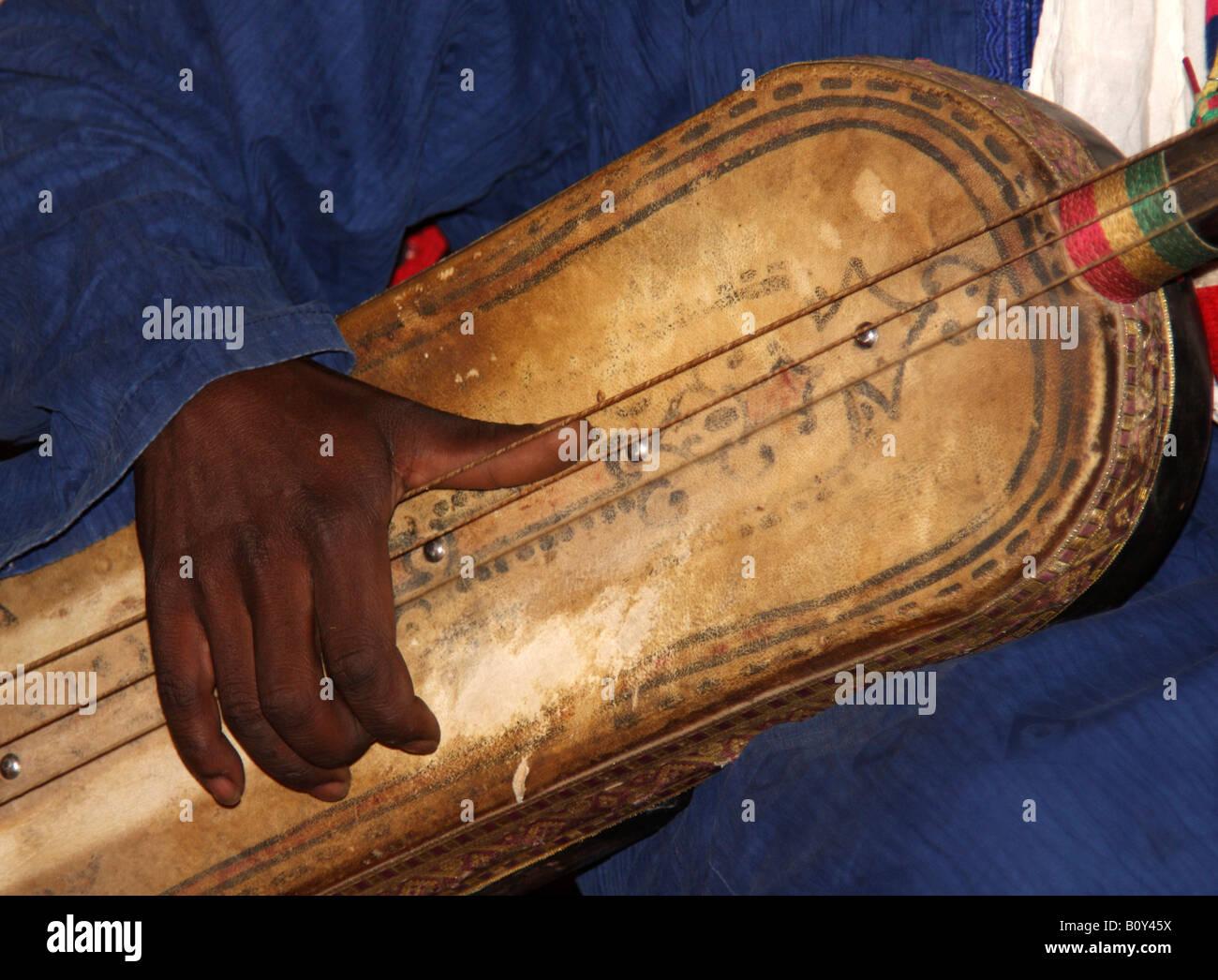 Hajhouj or guembri, Three stringed percussive lute, used in traditional Gnawa or Gnauoa Music of Khamlia - Stock Image