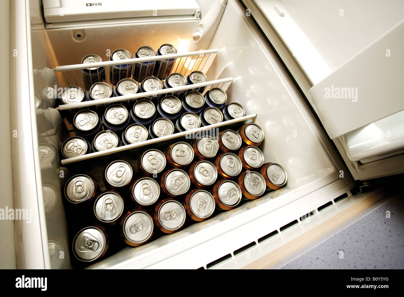 Beer Cans in fridge, low angle view - Stock Image