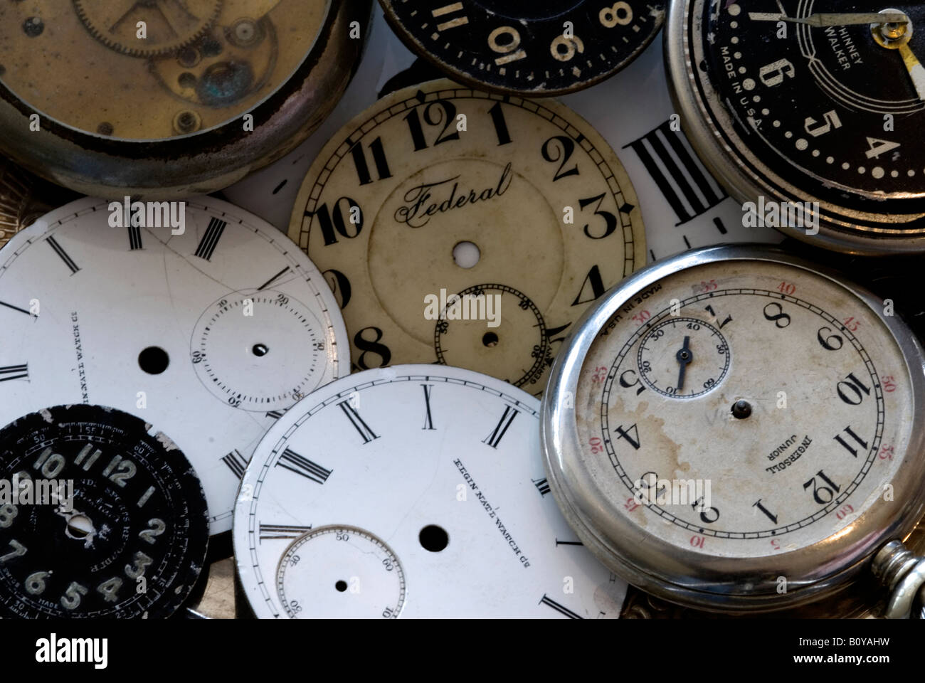 A close up of several old antique watch faces. - Stock Image