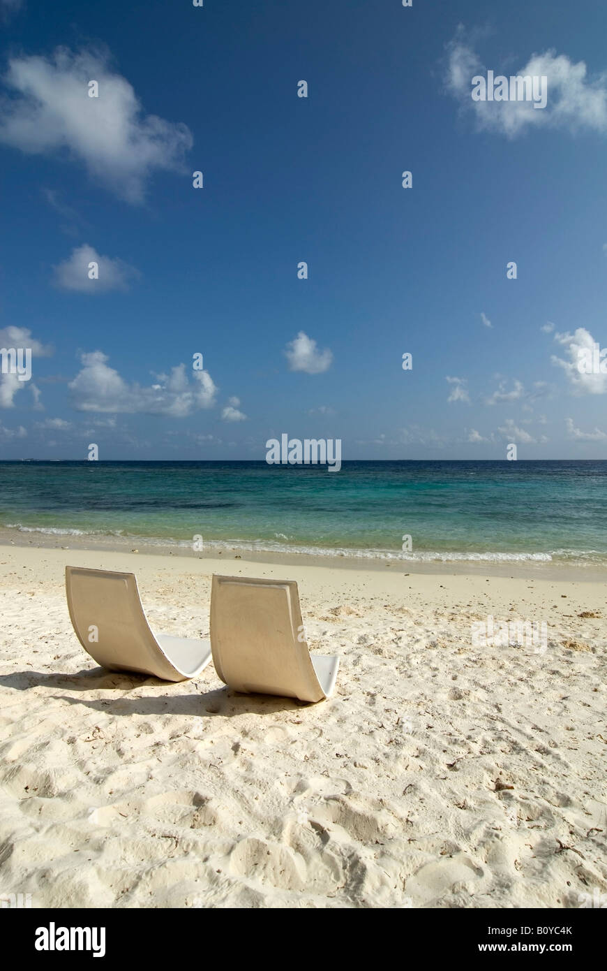 Maledives, Gan, Chairs on beach - Stock Image
