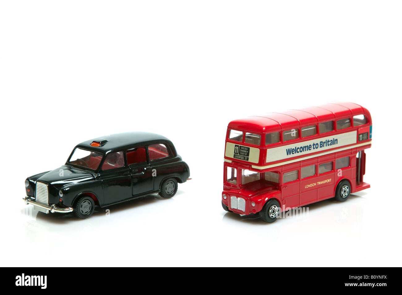 London Taxi and red double decker bus toys isolated on a white background - Stock Image