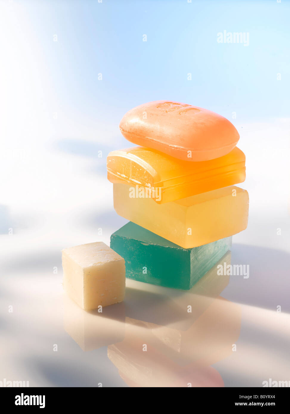 Colourful cakes of soap, stacked, close up - Stock Image