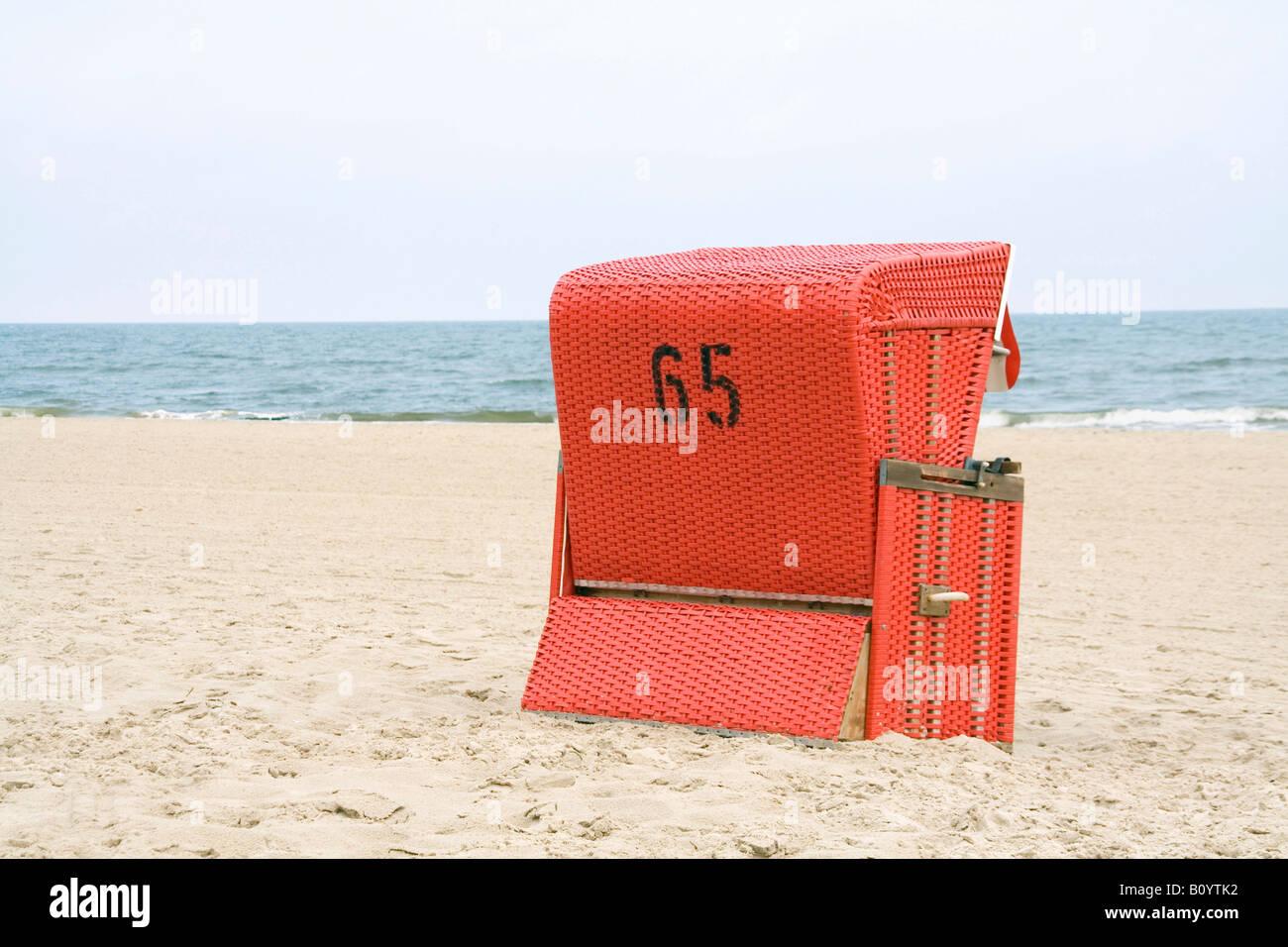 Beach chair on beach - Stock Image