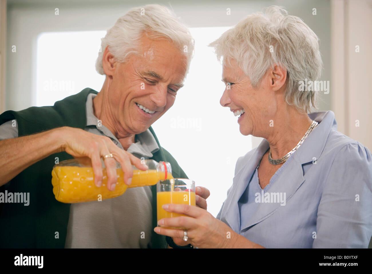 Senior couple, senior woman holding glass Stock Photo