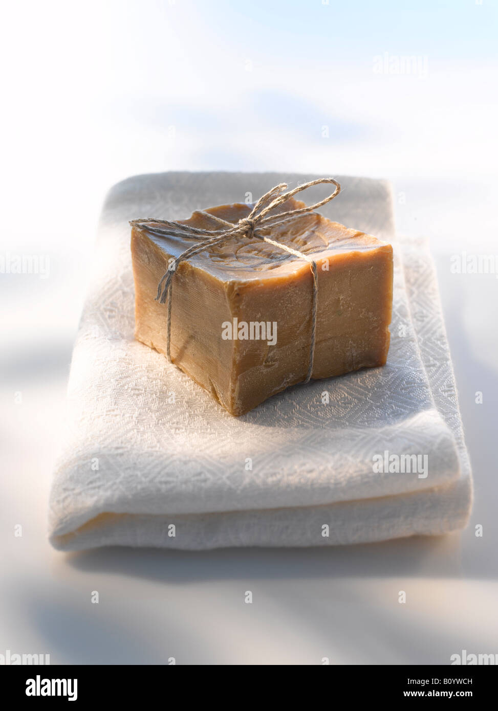Olive soap on towel, close up - Stock Image