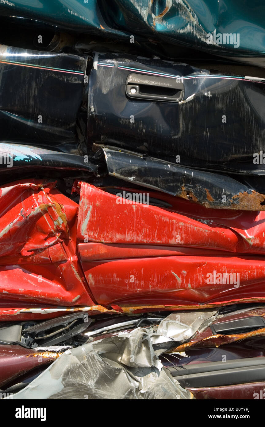 Smashed And Crushed Automobiles And Parts In An Auto Salvage Yard