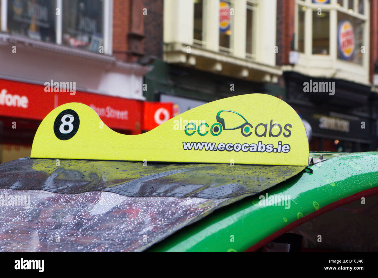 Eco cab in the rain Dublin Ireland - Stock Image
