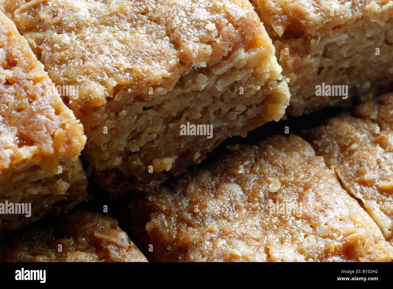 A macro or close up image of freshly baked flapjacks squares sliced and ready to eat - Stock Image