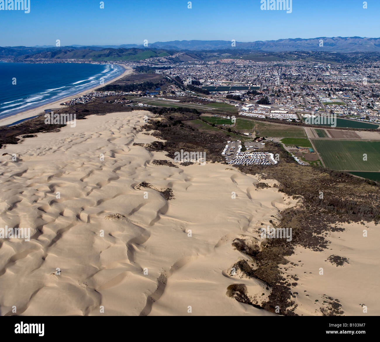 Aerial Above Pismo Beach Dunes And The City Of Oceano Ca