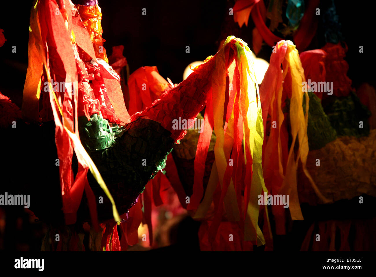 Piñatas on display at a mexican market - Stock Image
