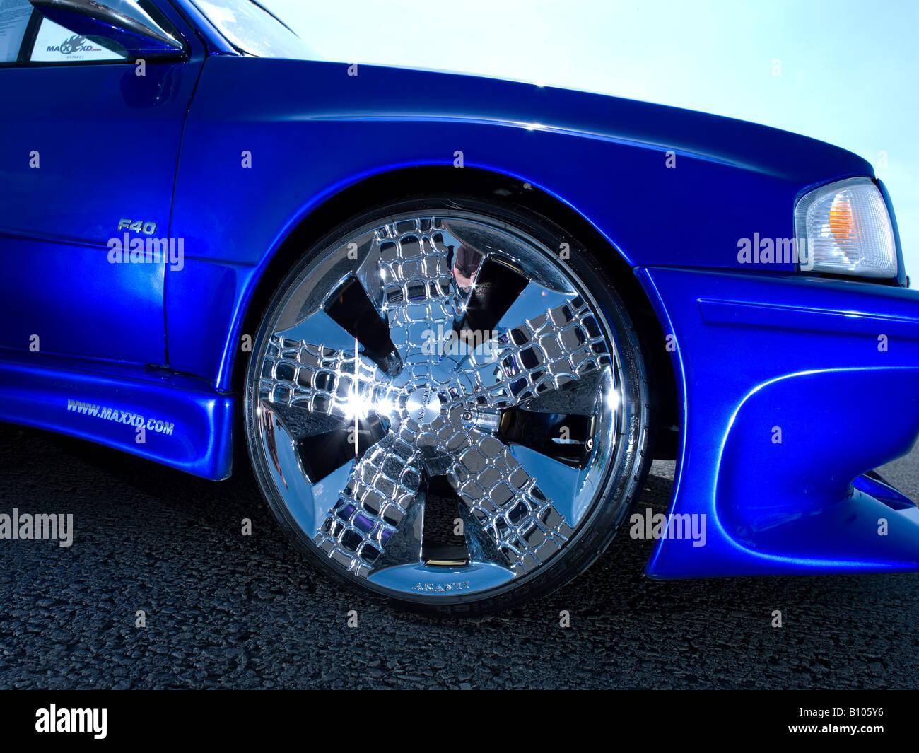 Chrome Wheel Rim Of Slammed Blue Ford Escort Modified Max Power Car