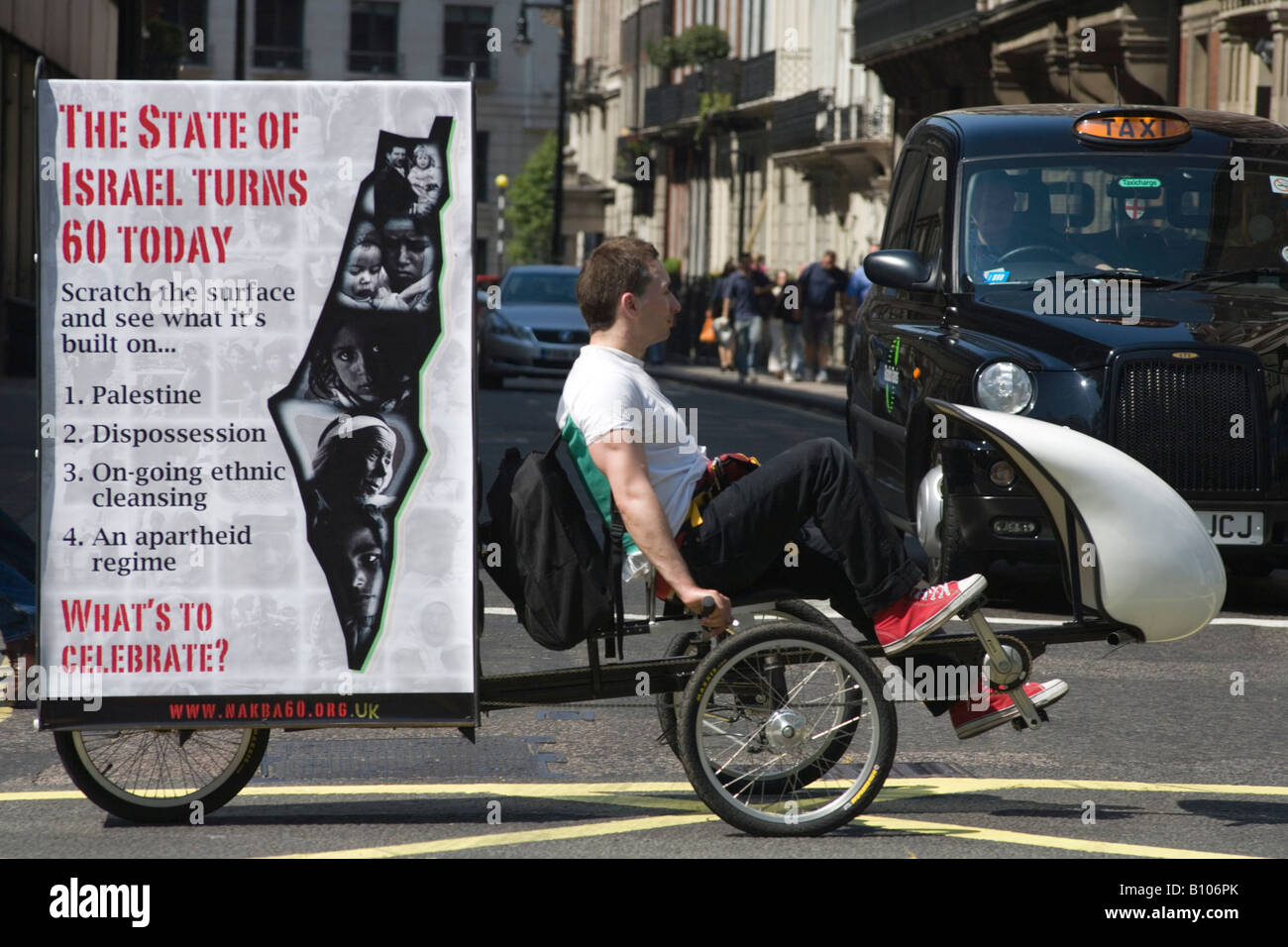 Nakba 60 anti Israeli protester cycles through Piccadilly London UK - Stock Image
