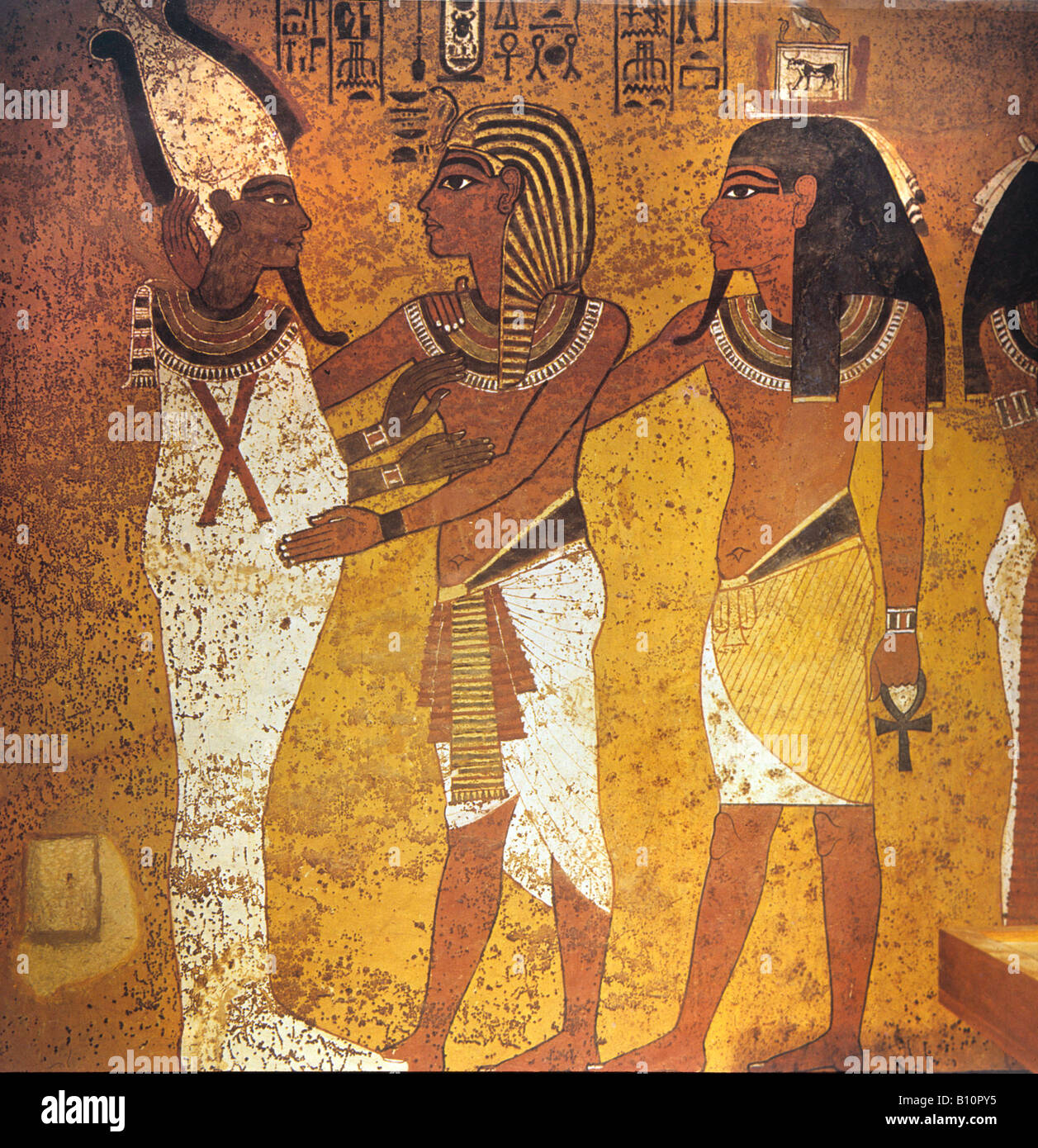 Tutankhamun's Tomb. Ffresco Tutankhamun and Ka embracing Osiris Egypt Stock Photo