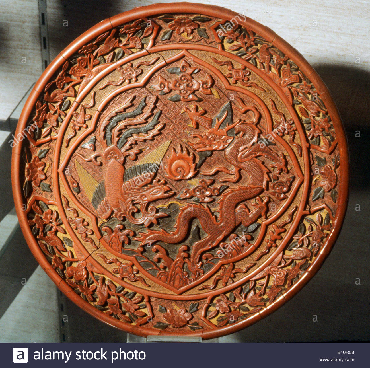 Ming Dynasty laquered dish with dragon and phoenix 15th c China AAAC Ltd - Stock Image