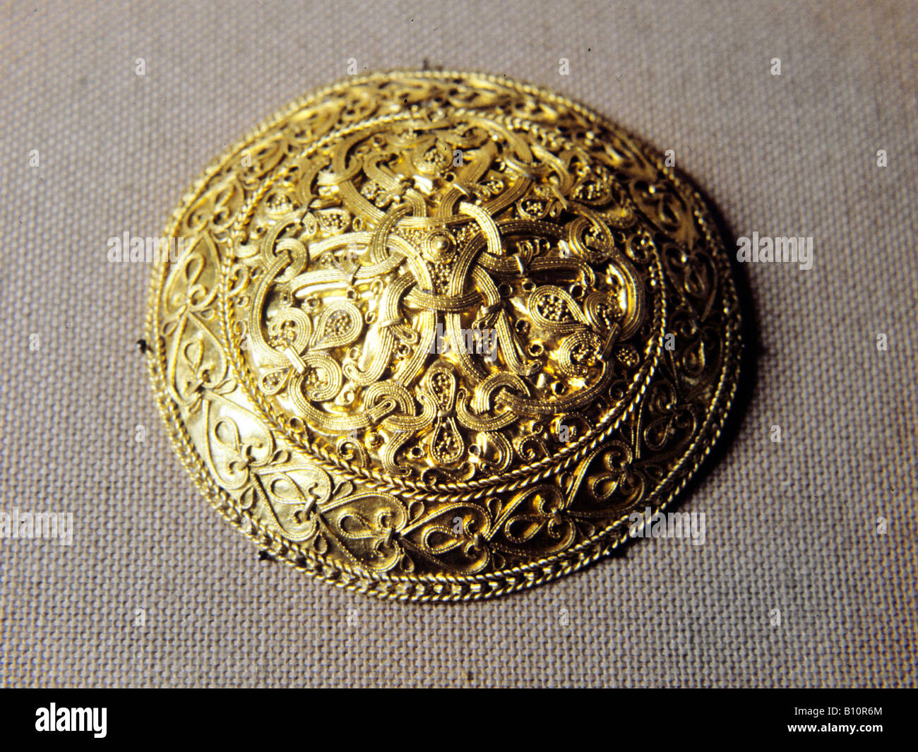 Viking artefact gold disk brooch Hornelund Denmark  Copyright: AAA Collection Ltd - Stock Image