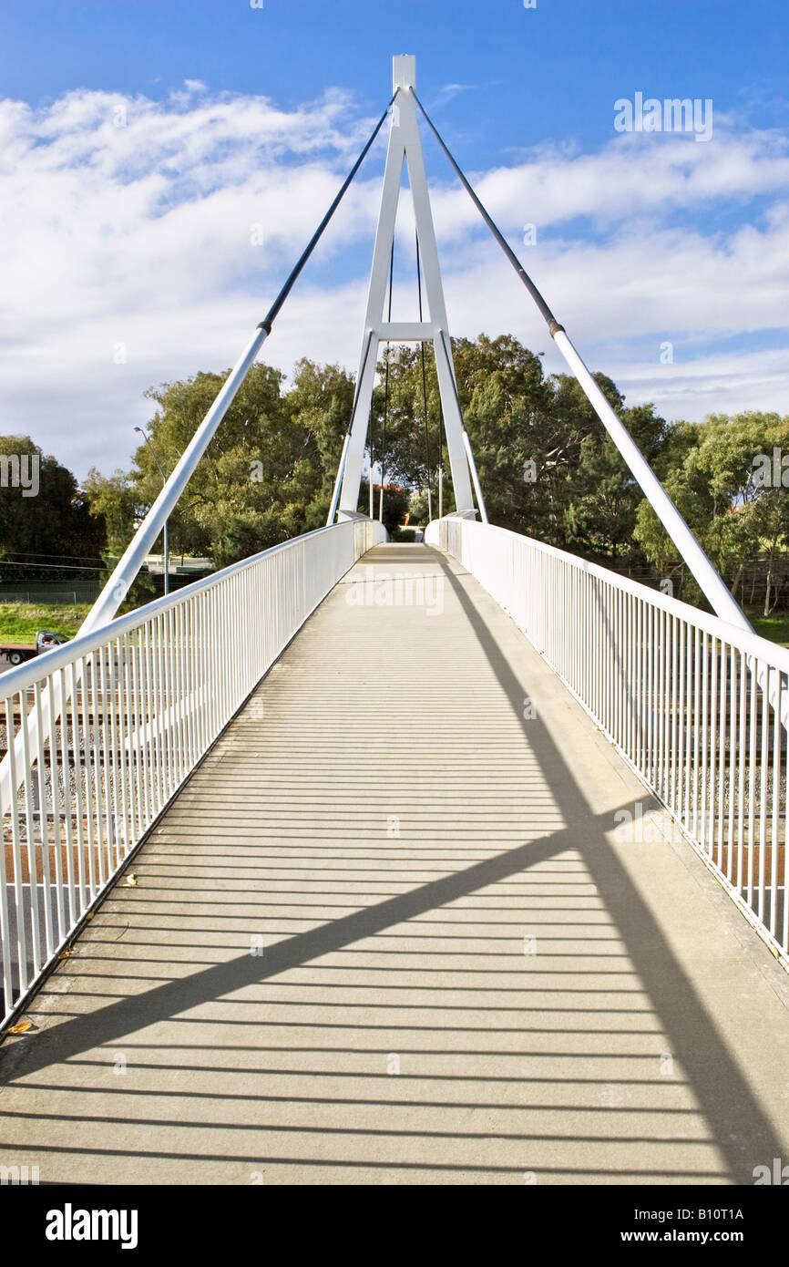 A suspension bridge footpath over a road - Stock Image