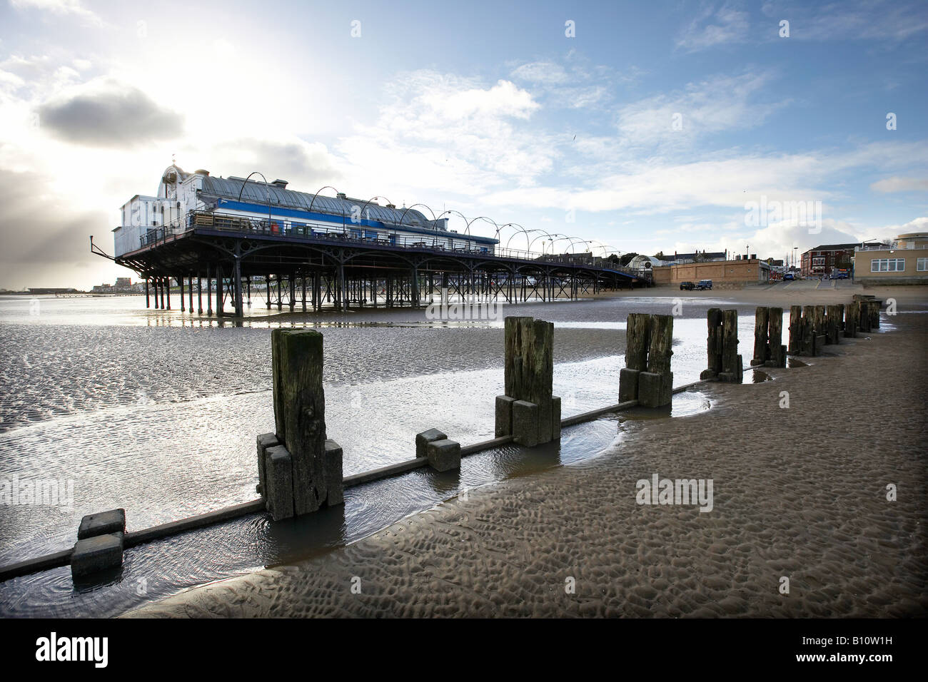The pier and wooden groynes Cleathorpes beach north Lincolnshire - Stock Image
